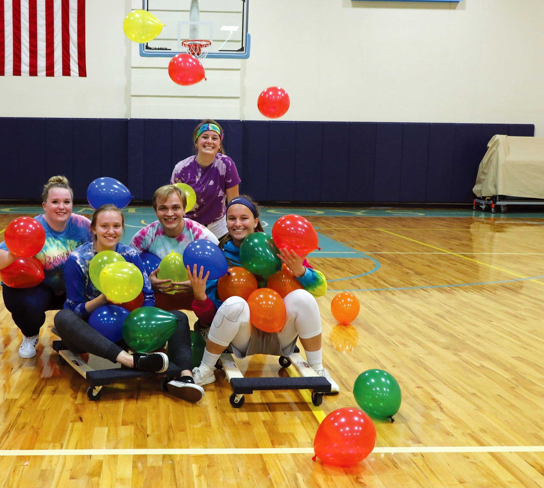Students playing balloon game in the gym