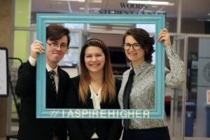 Student senators looking through frame