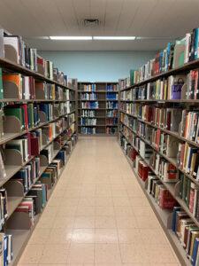 Shelves of Rooney Library.