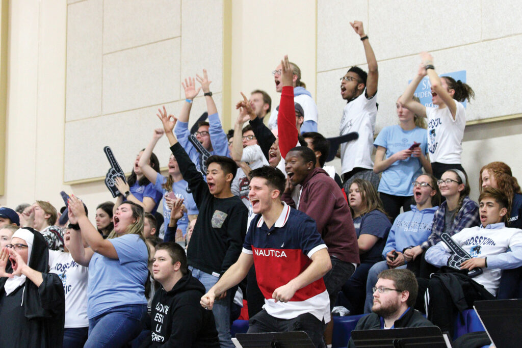 the fan section cheering at a basketball game