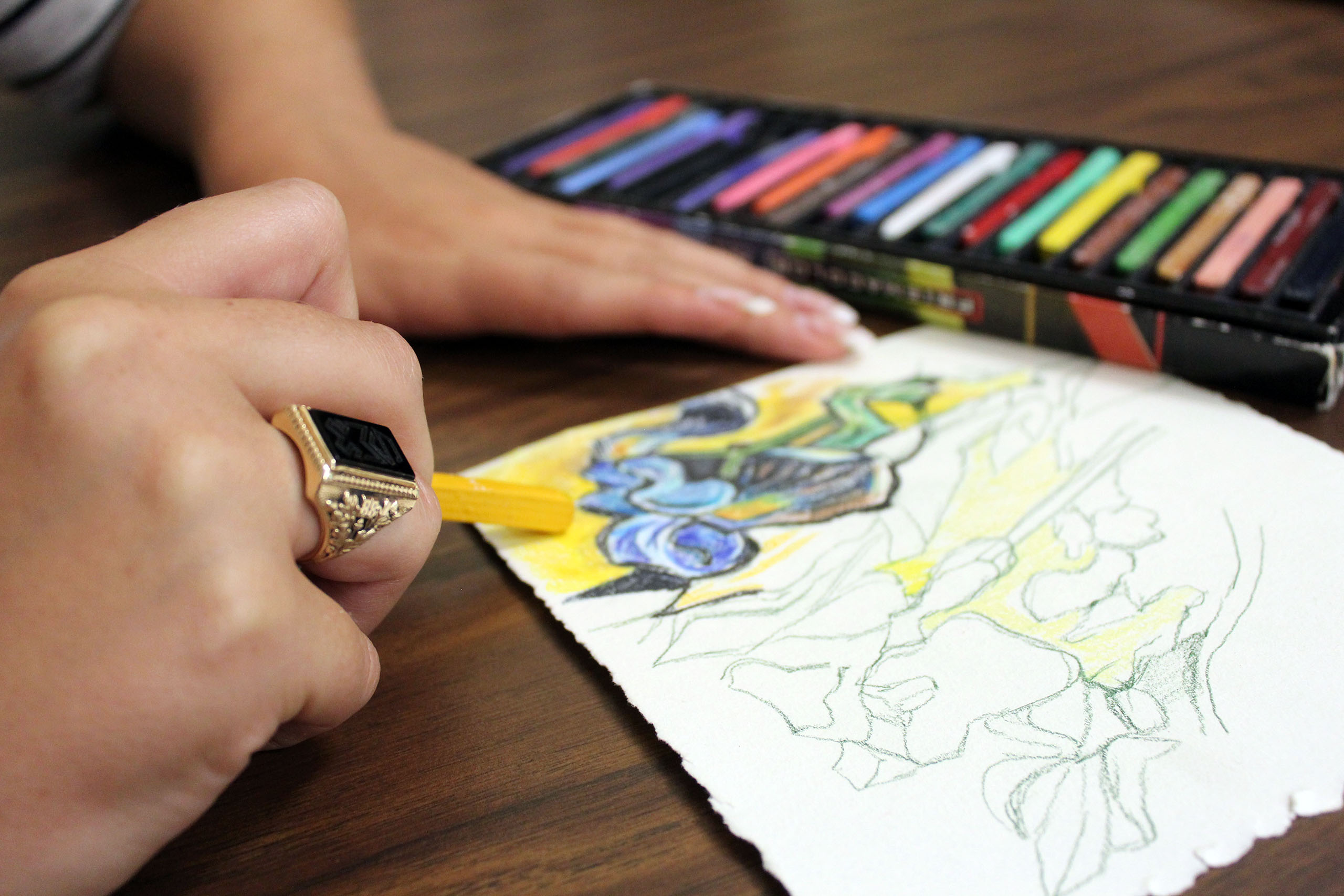 Art therapy student coloring with pastels