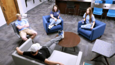 student hanging out in a common area