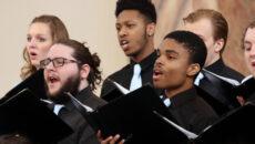 Men singing in choral concert