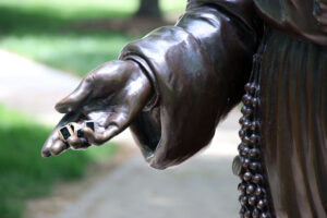 Three rings sit in the palm of the Saint Mary Theodore Guerin's sculpture's hand