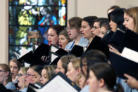 Closeup of chorale performing in the church