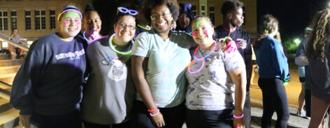 Group of friends at a late-night glow run