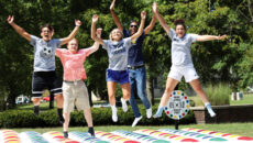 Students having fun with inflatable twister game