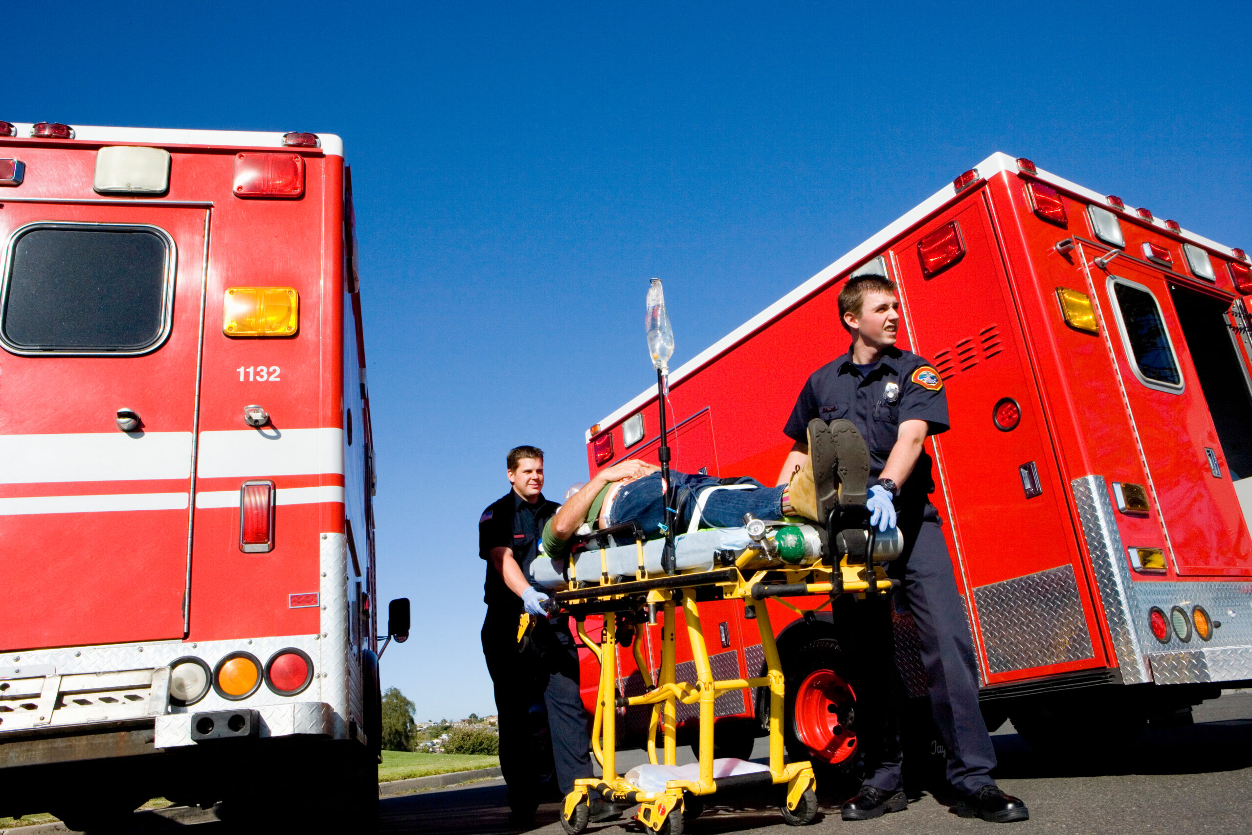 Paramedics with a patient on a stretcher