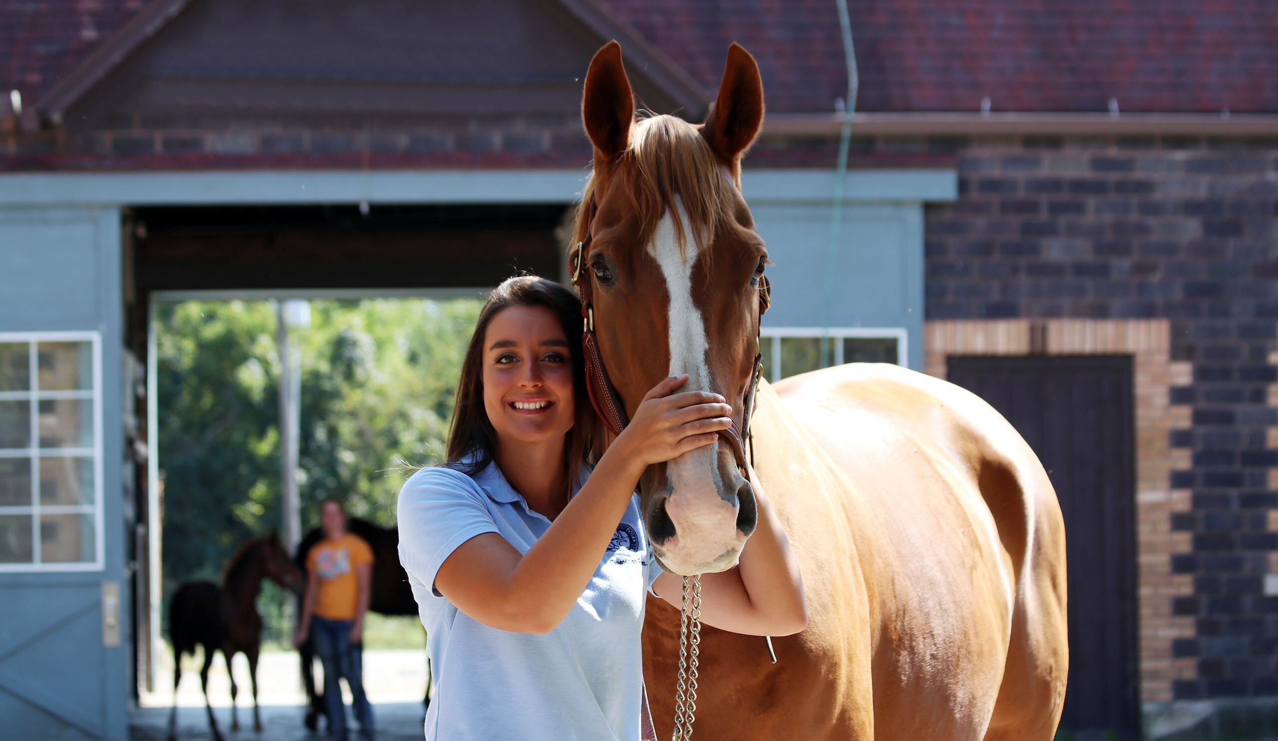 Savannah smiling with a horse