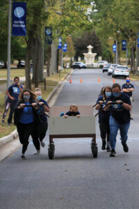 A team competing in the bed races