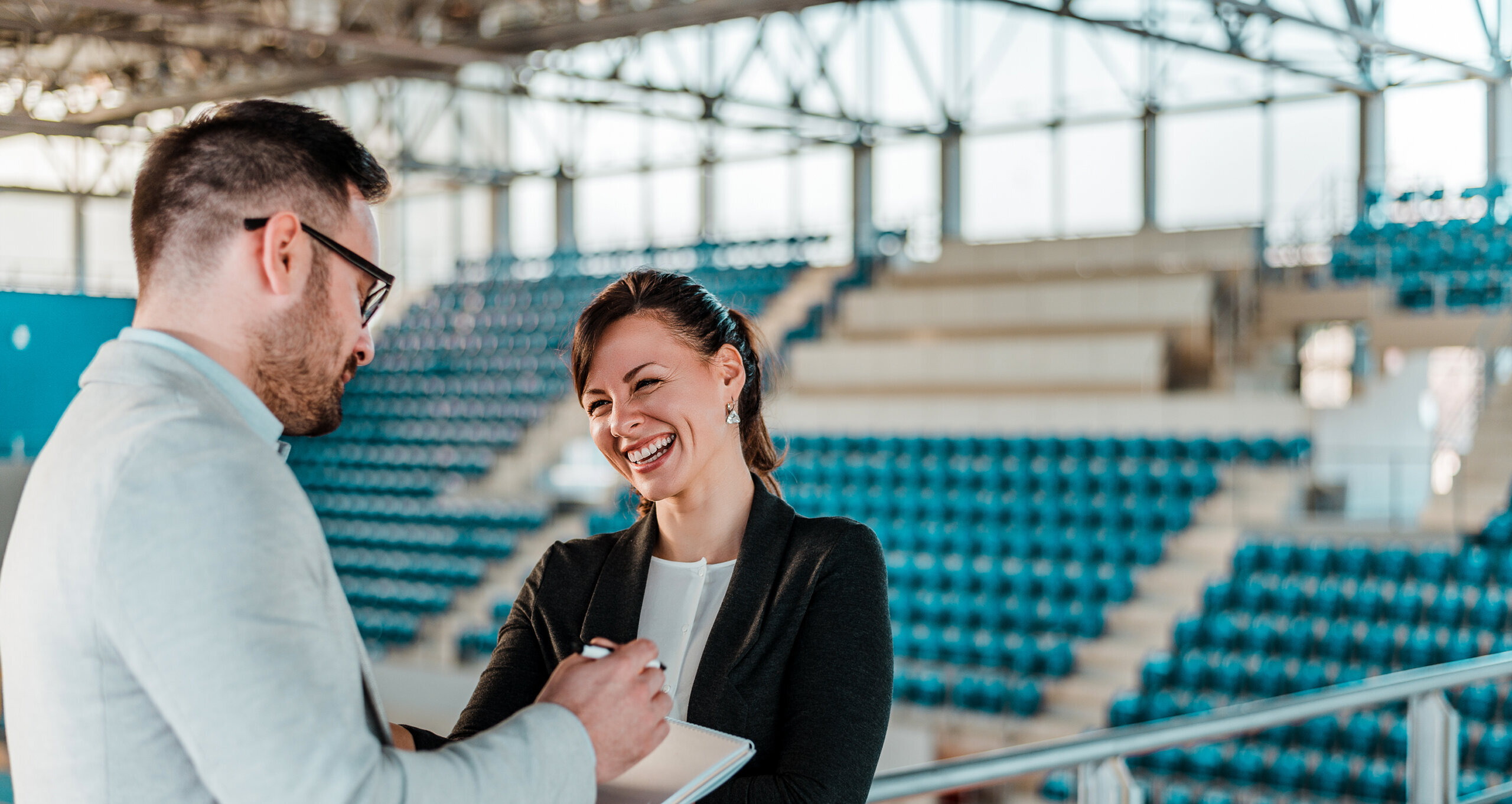 Sport managers conversing in athletics arena