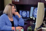 Jaclyn Walters at her desk
