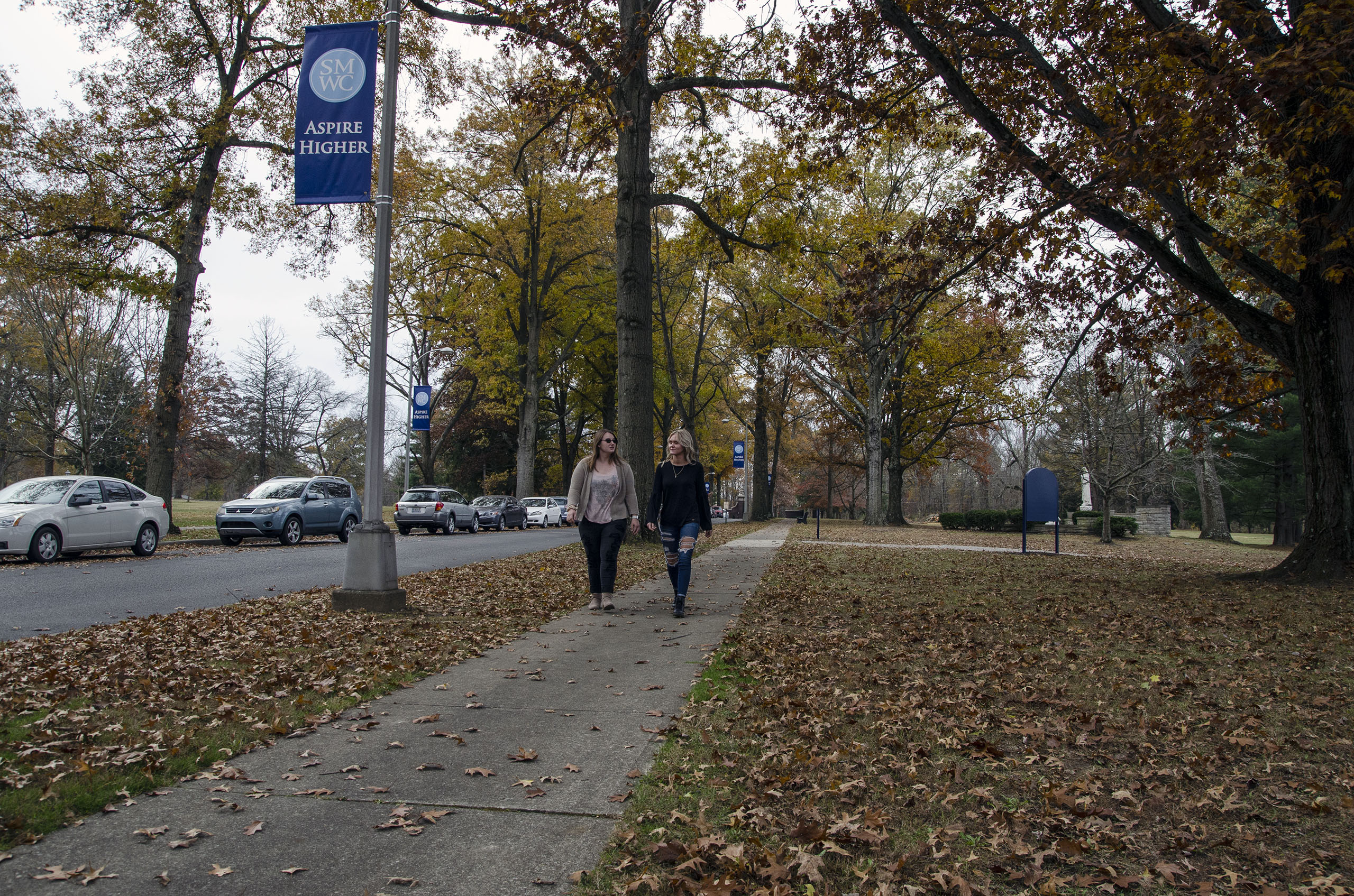 Two students walking down the Avenue