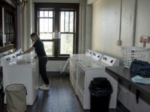 A student using Le Fer's free clothes washers