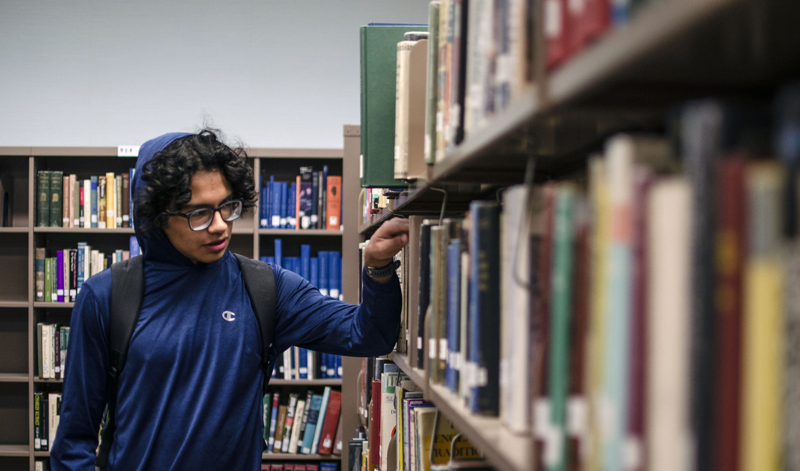 Student browsing books in the library
