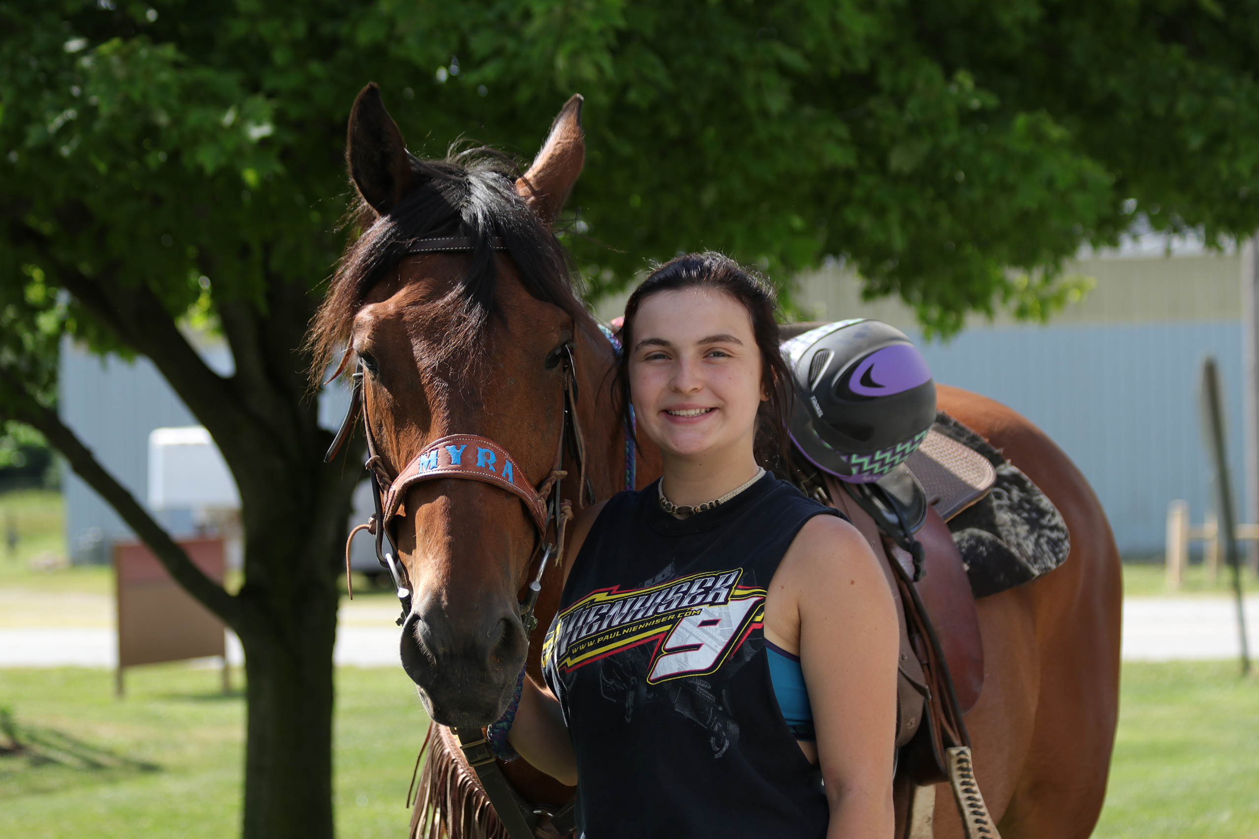female camper standing with her horse