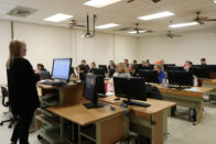 Instructor teaching class of students in computer lab