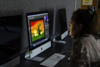 Student in computer lab working on digital art