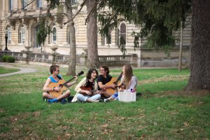 students on lawn playing instruments