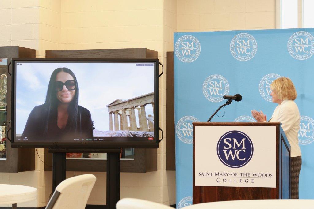 Dr. Pantazi on screen at press conference