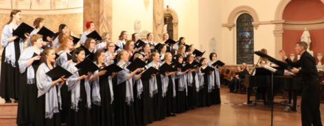 Choral students singing at a concert