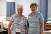 Janet Clark and Beth O'Connell standing in nursing lab