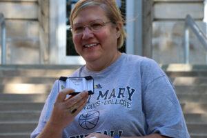 Nancy Payonk holding cross necklace