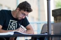 Guy studying outdoors
