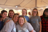 Group of alumni in the Beer & Brat tent at Homecoming 2017