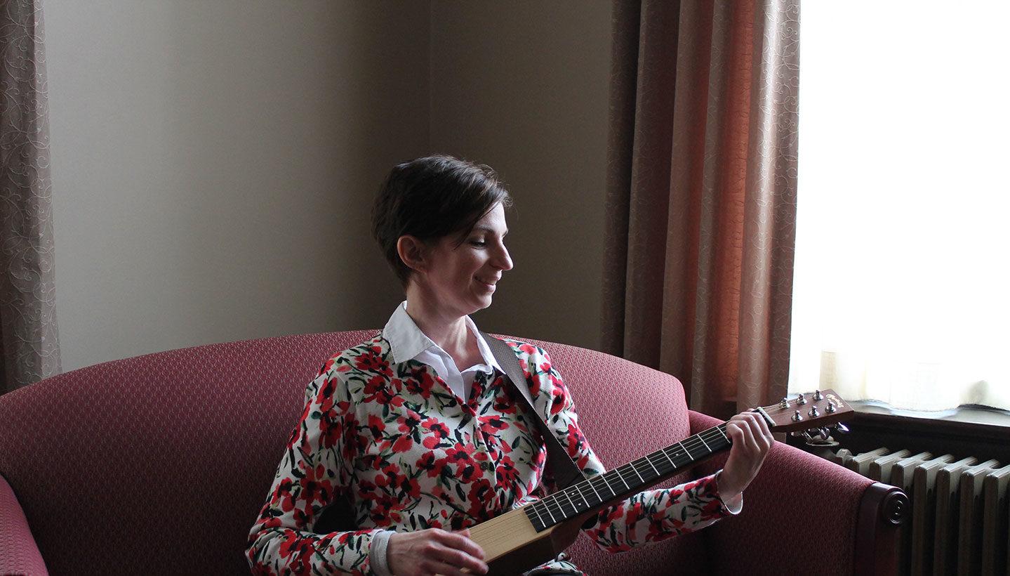 Arian Johnson playing guitar