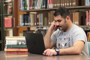 Saudi student studying in the library