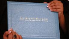 Closeup of student holding diploma