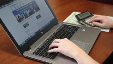 Person browsing financial aid site on laptop