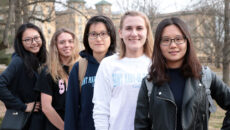 Group of campus and international students standing in a line