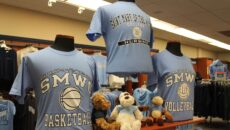 A SMWC basketball shirt, a SMWC volleyball shirt and several stuffed animals on display in the bookstore.