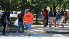 students and parents touring campus