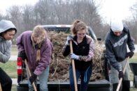 weeding behind Hulman Hall - sustainability