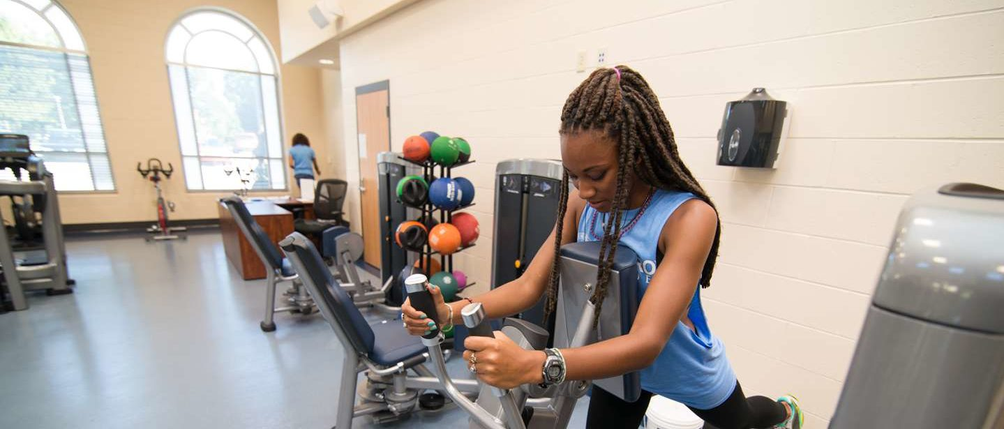 A young woman works out in the fitness center.