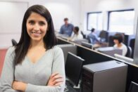 Woman standing in busy office